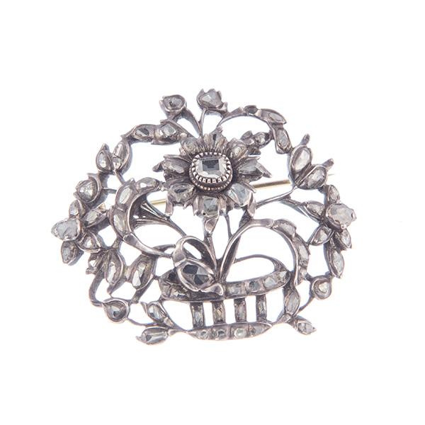 Broche canasto de plata montado con diamantes