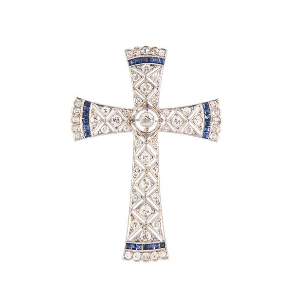 Broche cruz de oro y oro blanco, con diamantes y zafiros