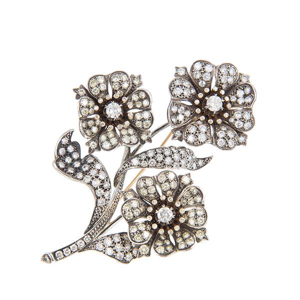 Broche rama de oro montada con diamantes