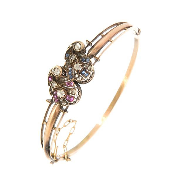 Pulsera rígida antigua de oro adornos de rubíes, zafiros y diamantes